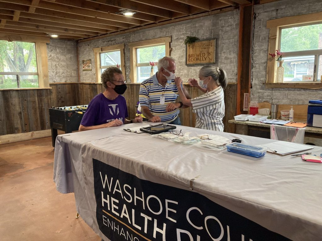 COVID-19 vaccine is administered at a local event.